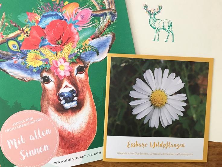 Hirsch mit bunten Blumen und Zeitschrift und Kräuterheft